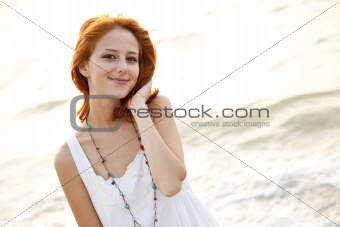 Beautiful young red-haired on the beach