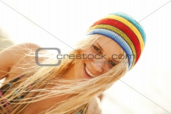 Beautiful young blonde girl in rastafarian hat