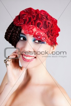Beautiful Young Woman with a Lace Headpiece