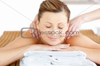 beautiful woman with close eyes receiving a back massage