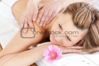 Blissful young woman enjoying a back massage