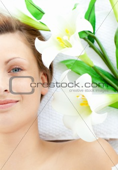 Beautiful woman lying on a massage table in a spa