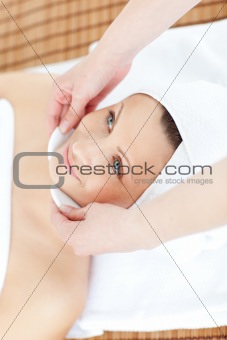 Positive woman receiving a beauty treatment