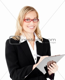Charming businesswoman writing on a clipboard