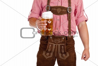 Bavarian man with leather trousers (Lederhose) holds Oktoberfest beer stein
