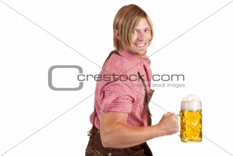 Bavarian man shows biceps muscles and holds oktoberfest beer stein