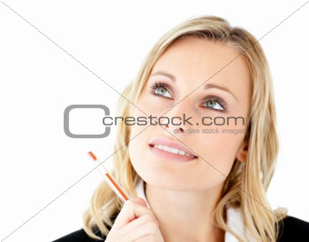 Thoughtful young businesswoman looking upwards
