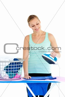 Bright woman ironing her clothes