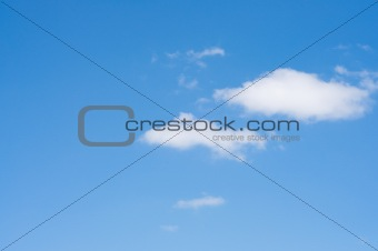 Blue sky with white small clouds.