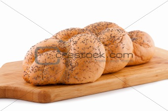 Bread roll with poppy white background.