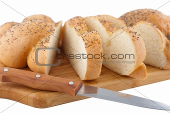 Bread slices on board with knife.