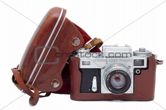 Old camera in cover isolated on white background.