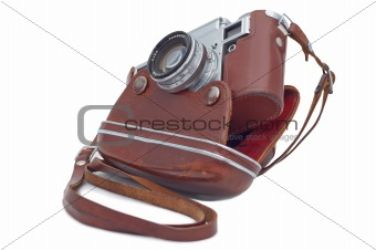 Old camera in cover isolated on white.