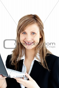 bright woman in suit holding a laptop