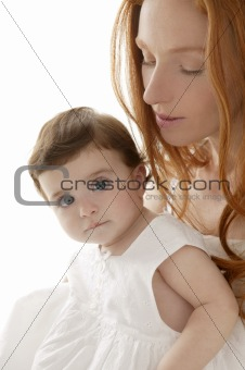 baby and mom in love hug white