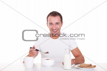handsome man taking breakfast, isolated on white, studio shot