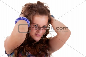 beautiful young woman, holding her hair with his hands, isolated on white. Studio shot