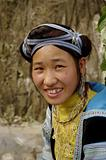 Portrait of a young blue Hmong woman