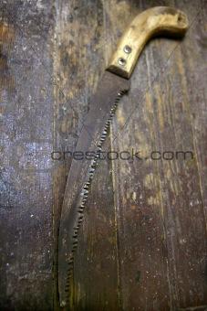 Aged grunge wood saw tool
