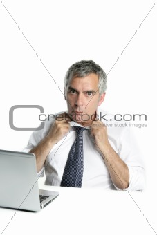 senior businessman stressed gesture open neck tie