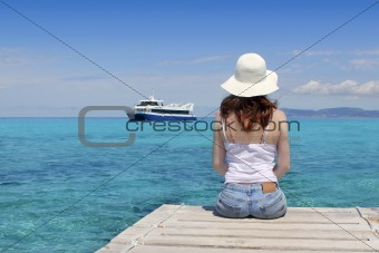 Tourist back woman looking Formentera turquoise sea