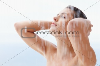 Sexy woman bathing under an outdoor shower