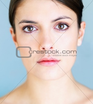 Closeup portrait of a beautiful young woman with gentle makeup