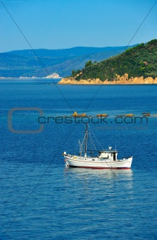 Fishing trawler among Greek islands