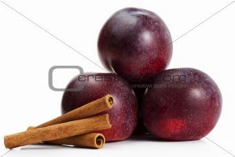 three plums and cinnamon sticks