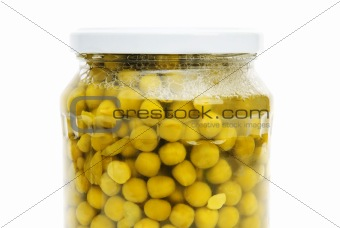 Green peas in glass jar isolated on white