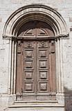 SS. Trinit Church. Wooden Portal. Gubbio. Umbria.