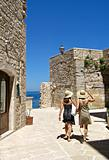 Tourists walking in Giovinazzo. Apulia.
