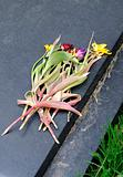 Wilted flowers on gravestone