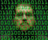 Man monitoring green binary code