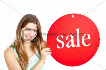 "Bright young woman holding a red panel where ""sale"" is written"