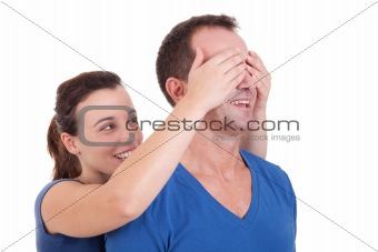 Portrait of a happy woman covering his man eyes, to surprise him