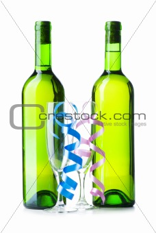 Bottle of wine and glass with streamer on white