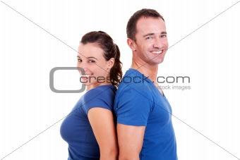 couple  back to back smiling, isolated on white, studio shot