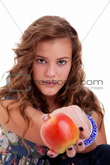 Beautiful girl with a red apple, isolated on white background. Studio shot.
