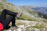 Person Relax on Top of a Mountain Against Great Panorama
