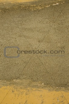Grunge cement and yellow wall background