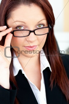 Charismatic caucasian businesswoman holding her glasses