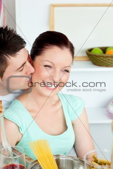 Caucasian couple preparing spaghetti in the kitchen