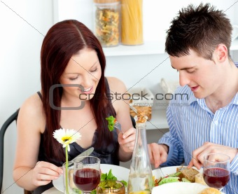 Affectionate caucasian couple having dinner at home