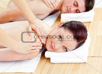 Bright young couple receiving a back massage
