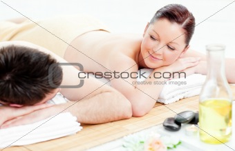 Adorable young couple lying on a massage table