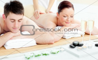 Charming young couple enjoying a back massage