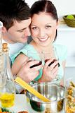 Loving young couple cooking spaghetti in the kitchen