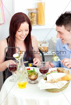 Caucasian couple having dinner in the kitchen