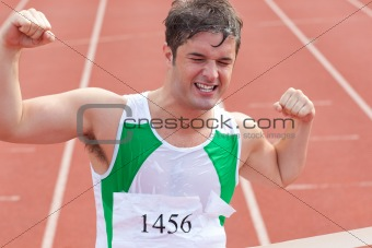Ecstatic sprinter showing expression of victory in front of the